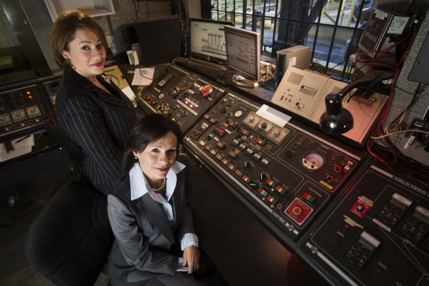 asphalt plant control room with two women in it