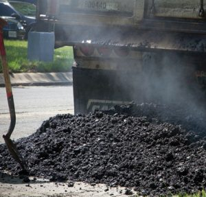 asphalt being spread with a machine