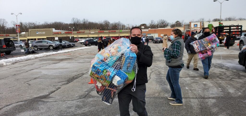 Men carrying bags of toys