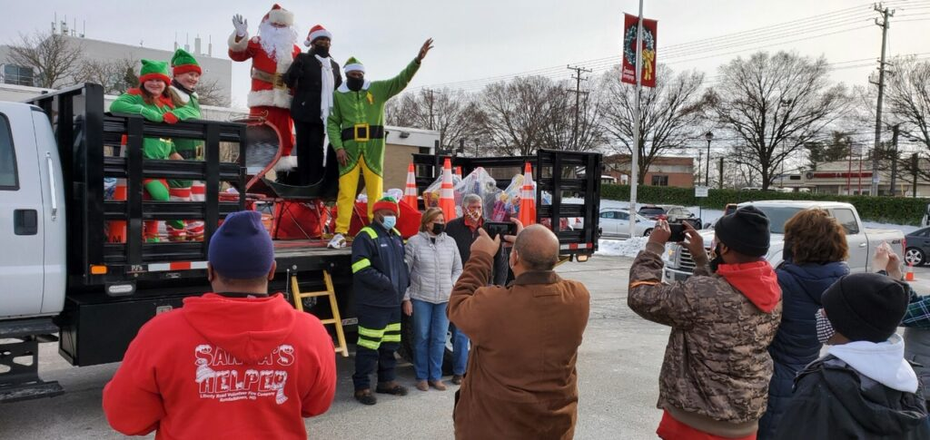 Santa and helpers with Speaker Jones on back of a truck