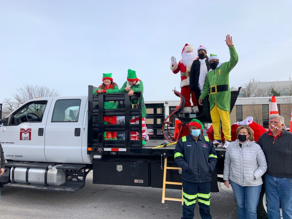 children, Santa, elf, Speaker Jones on back of truck
